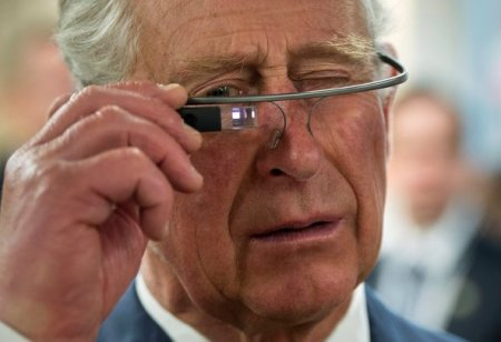Prince Charles trying on Google Glass in Winnipeg, Canada, in May 2014. Original photo featured in The New York Times article , December 2014.